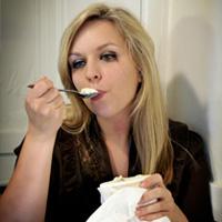Sad woman eating ice cream