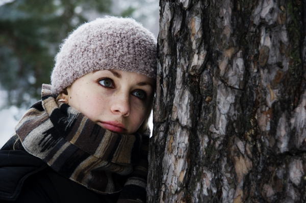 Sad woman in snow