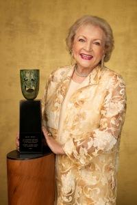 Betty White next to her SAG Award