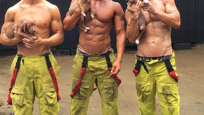 Smokin'-hot firemen are posing with pups,