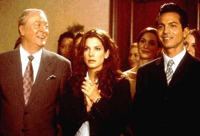Michael Caine, Sandra Bullock and Benjamin Bratt share a laugh
