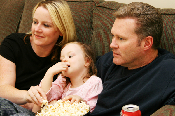 Family Watching a Movie on Couch