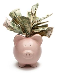 piggy bank with dollar bills