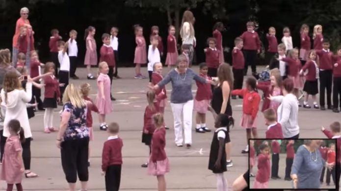 Retiring teacher gets 'flash-mobbed' on her