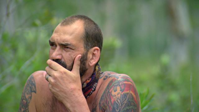 Scot Pollard watches Reward challenge unfold on Survivor: Kaoh Rong