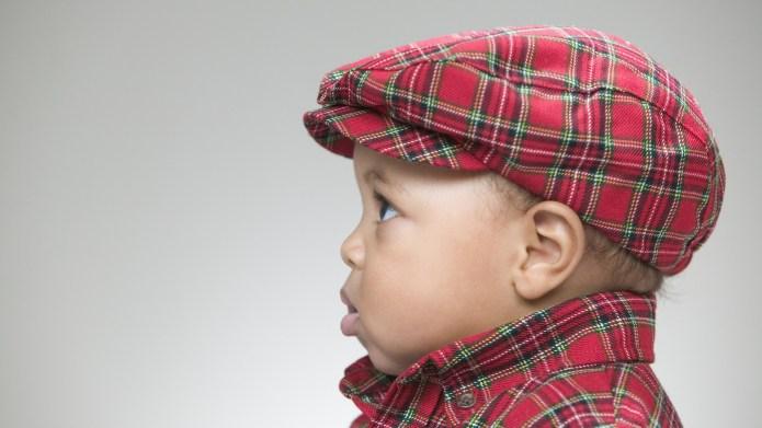 Cute baby wearing a flat cap