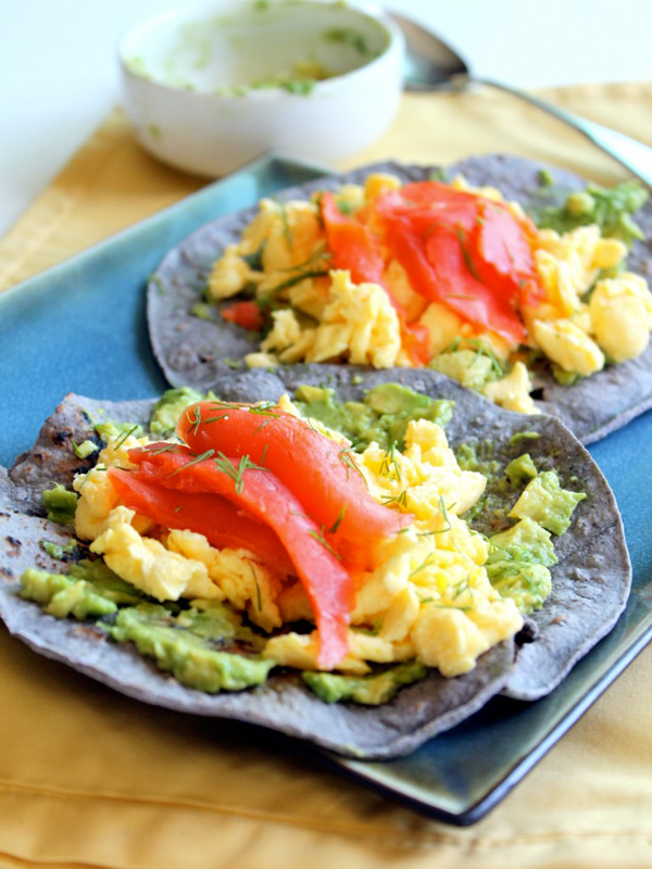 Blue corn breakfast tacos with scrambled eggs, smoked salmon, avocado, and dill