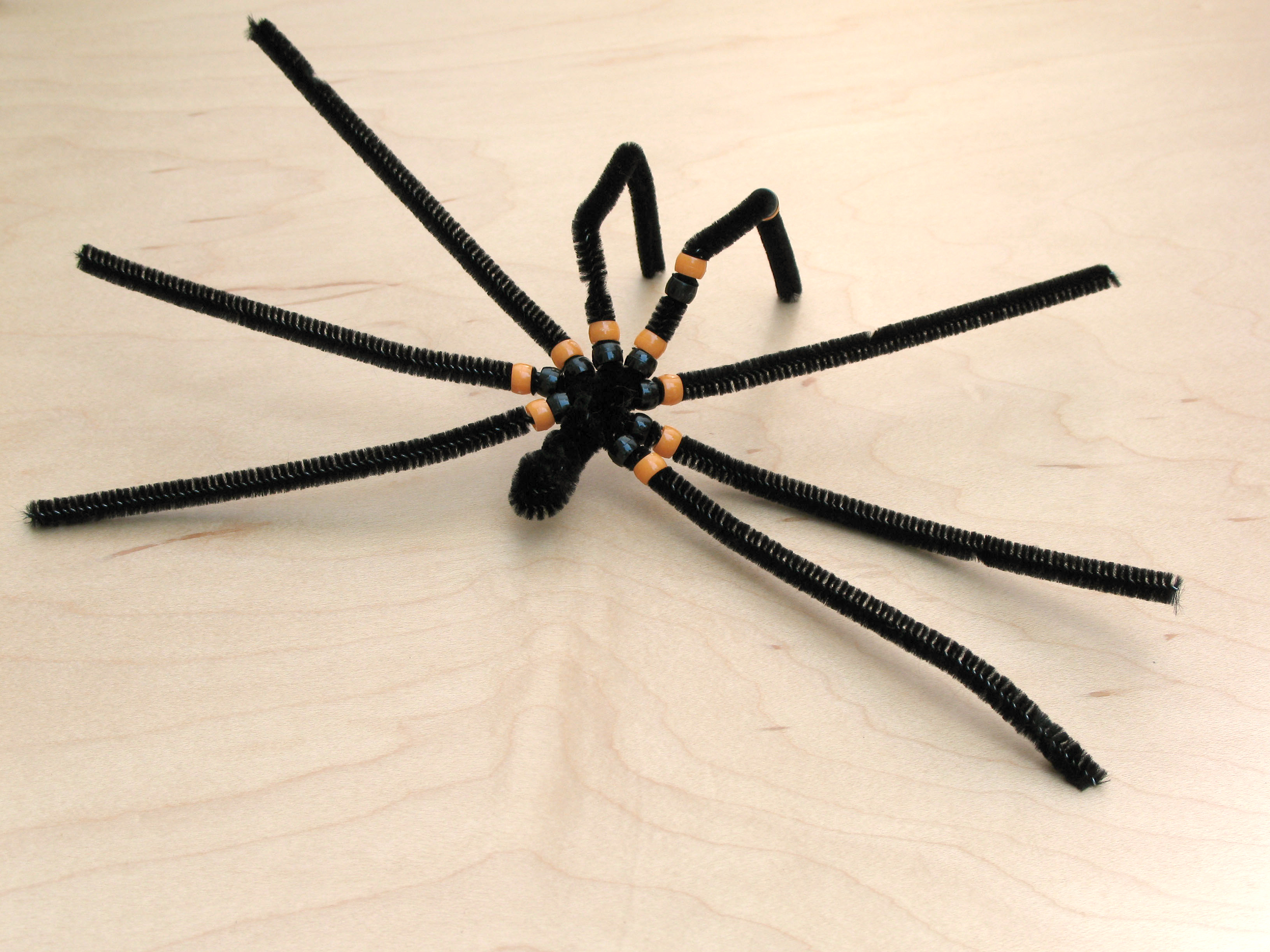 Step 3 - add the beads to the spider legs