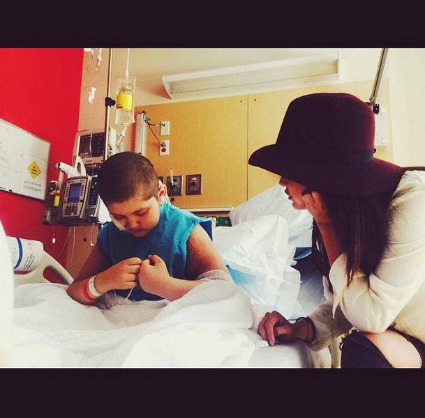 Selena Gomez poses with sick child at Children's Hospital Los Angeles