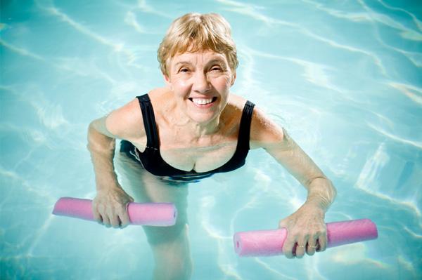 Senior woman water aerobics
