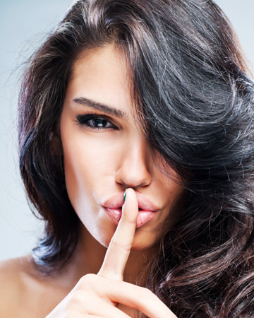 Sexy woman whispering