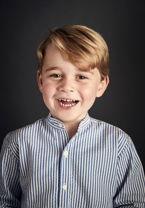 Prince George smiles in his birthday portrait