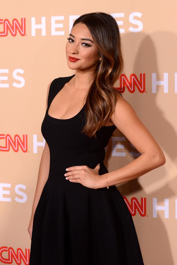 Shay Mitchelle wearing simple black dress