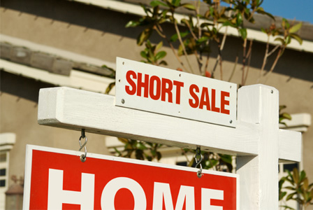 Short sale sign on home
