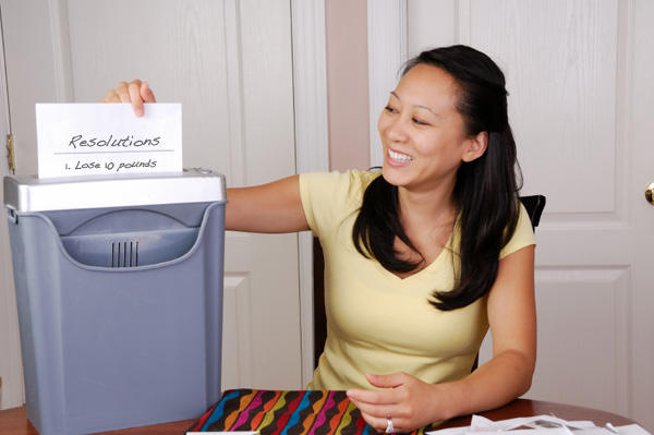 Woman shredding resolution list