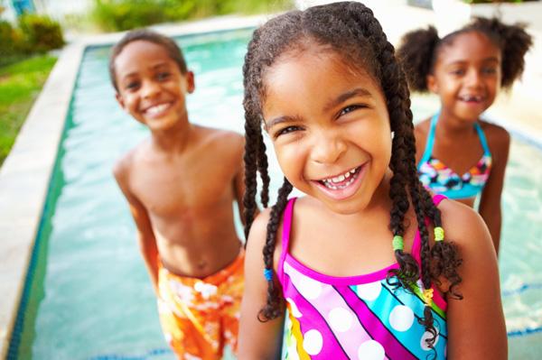 Siblings at swimming pool