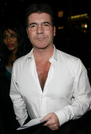 Simon Cowell's caught in the middle of a divorce