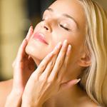 Woman using skin care treatment