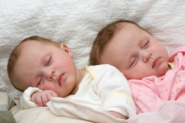Sleeping twin babies