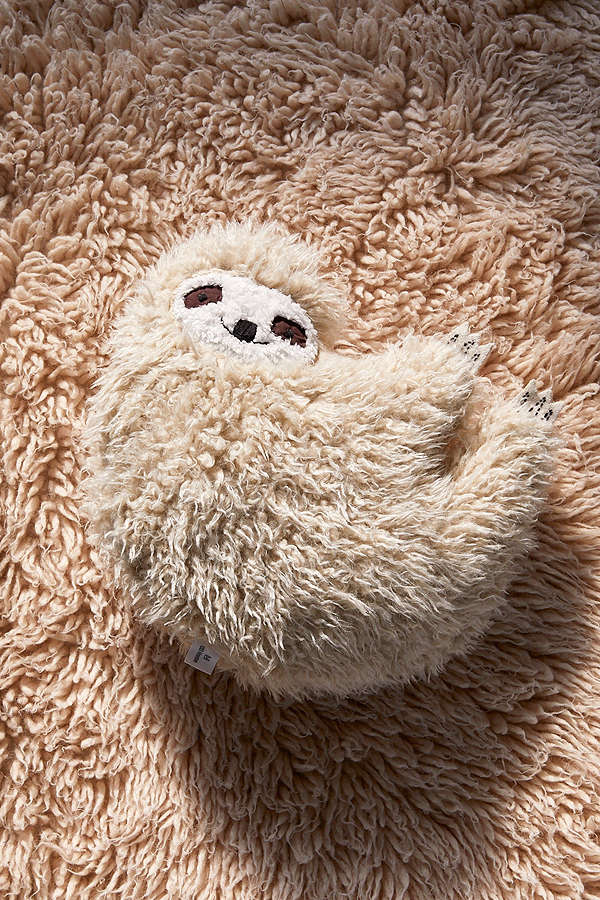 Gifts for Impossible People | Furry Sloth Pillow at Urban Outfitters