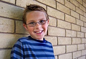 Smiling happy boy - by Synchronista