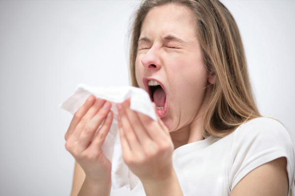 Sneezing Woman with Allergies