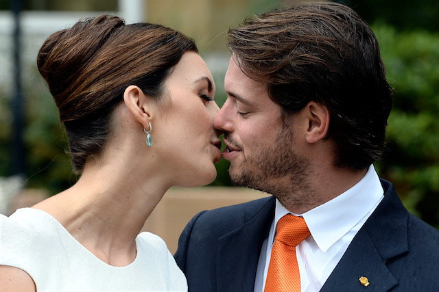 Prince Felix of Luxembourg & Princess Claire of Luxembourg kiss on their wedding day