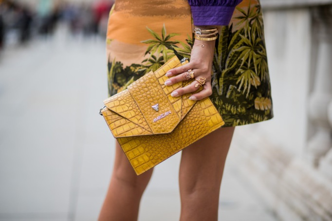 Assorted rings with a yellow alligator clutch