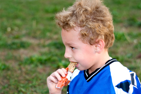 Soccer boy eaitng snack