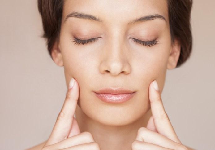 Woman massaging her face