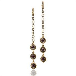 Our pick: Sitara gold three-tiered dangling earrings, $22. Jessica Simpson.