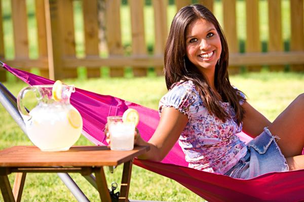 Spring woman drinking lemonade