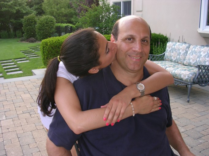 Daughter giving dad a kiss on the cheek