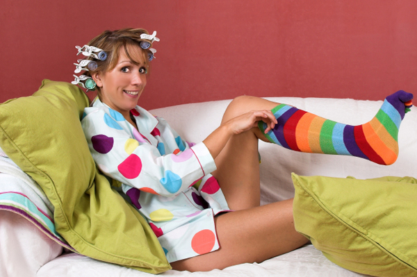 Woman in Curlers and Funny Socks