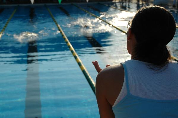 Mom Cheering on Swimming Child