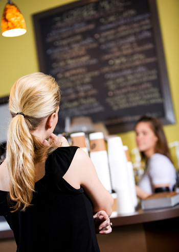 Woman in Line at Coffee Shop