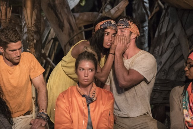 Stephanie Gonzalez whispers at Tribal Council on Survivor: Ghost Island