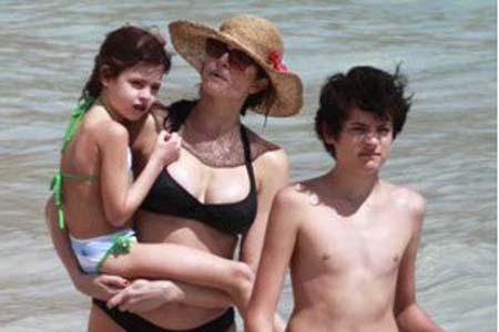 Stephanie Seymour hits the beach with her son