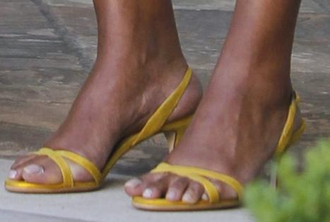 Toes hanging out over sandals