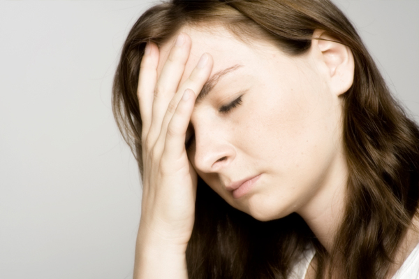 Stressed Woman holding head
