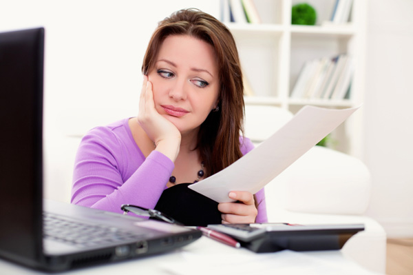 stressed woman with bills