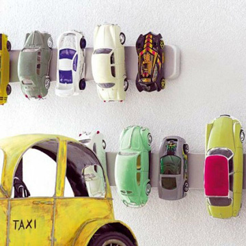 Yet another creative way to use Ikea magnet knife holders is to store car toys.