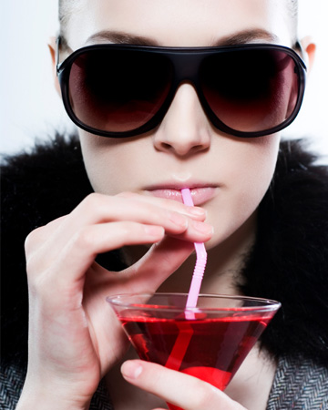 Stylish woman drinking cocktail