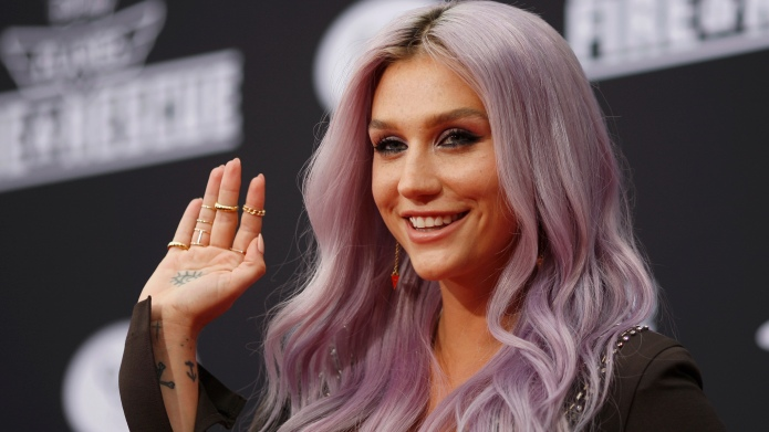 Recording artists Kesha arrives to the