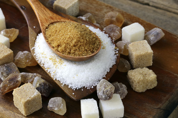 Sugar with wooden spoons
