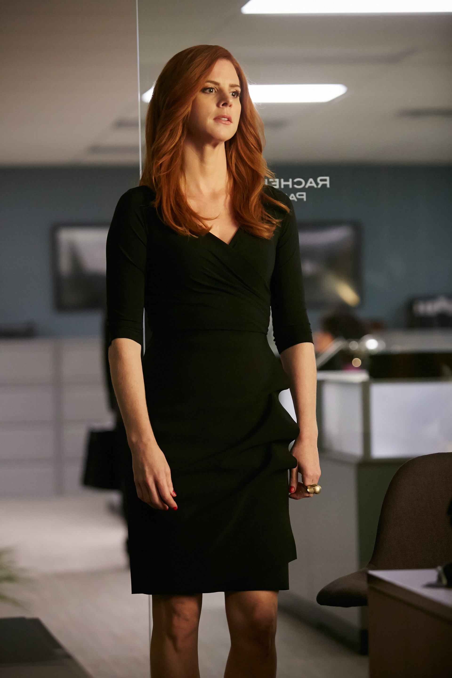 Exclusive fashion photos from Suits: Black wrap dress