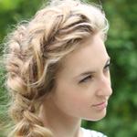Blonde woman with long spring braided hairstyle