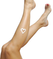 Isolated legs with sunscreen heart