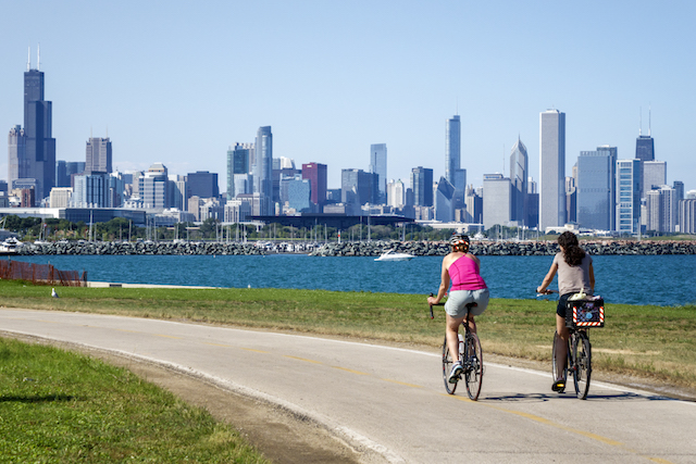 Bikers riding along the Lakefront Trail of 39th Street Beach in Chicago