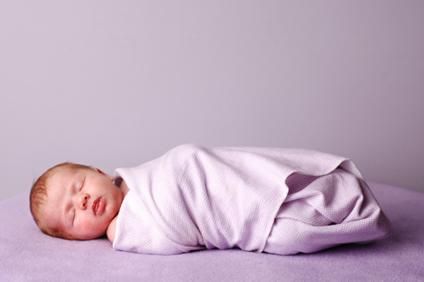 Swaddled baby girl